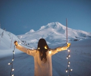 girl, light, and snow image