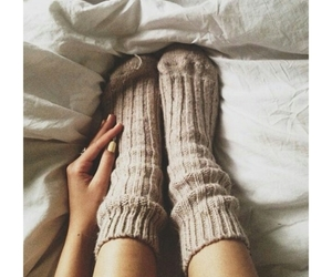 bed, cozy, and legs image