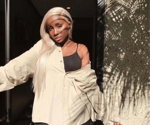 grey hair and melanin image