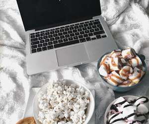 popcorn, bed, and cozy image