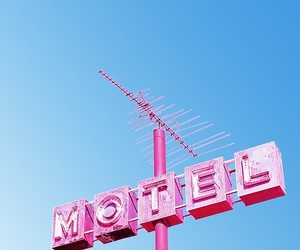 clear sky, motel, and neon image