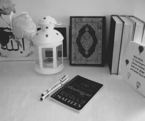 books, candle, and quran image
