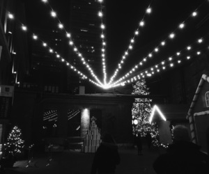 black and white, fairy lights, and night time image