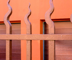 building, orange, and gate image