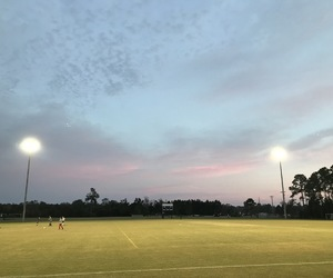 soccer field and sunset image