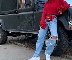 white sneakers, light blue jeans, and red crop turtleneck image