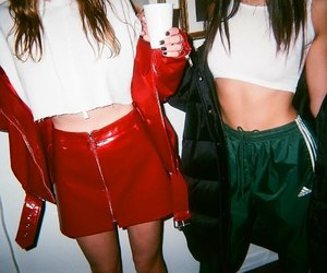 white crop tank top, red leather skirts, and green adidas pants image