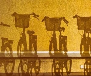 yellow, bike, and shadow image