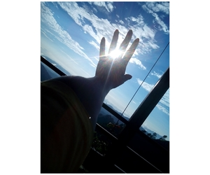 hands, sky, and sun light image