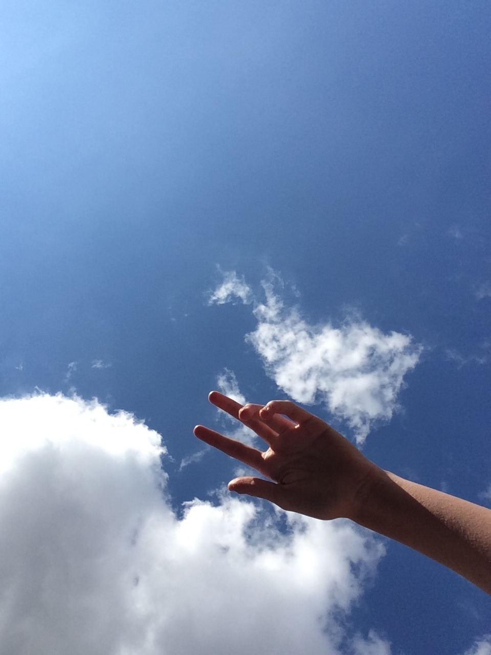 sky, clouds, and hand image