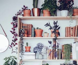 book, plants, and decor image