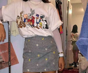 white turtleneck, white graphic t-shirt, and gingham skirts image