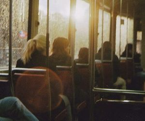 sun, bus, and people image