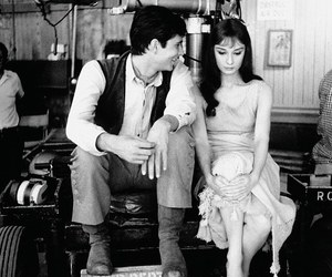 audrey hepburn, anthony perkins, and black and white image