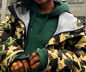 green hoodie and camo jacket image