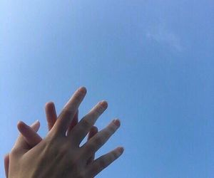 sky, hands, and blue image
