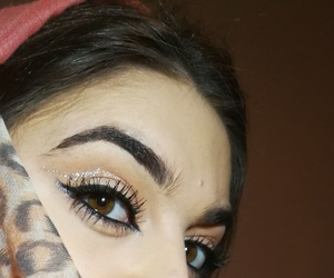 eyebrow, glitter, and green eyes image