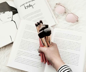 Brushes, makeup, and book image