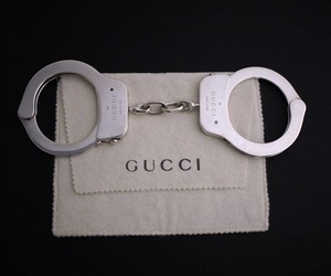 gucci and handcuffs image