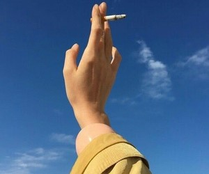 sky, cigarette, and hand image