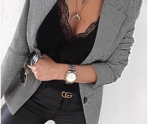 black jeans, necklaces, and black blouse image