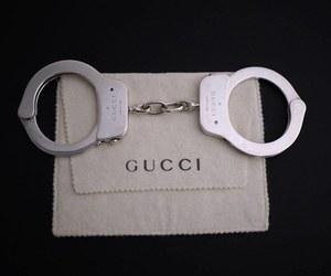 gucci and handcuffs image