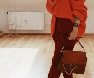arm tattoo, brown purse, and ankle tattoos image
