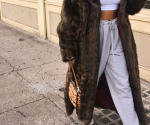 brown purse, white sneakers, and white crop turtleneck image