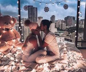 couple, kiss, and lights image