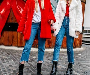 blue jeans, red sweatshirts, and black ankle booties image