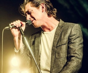 alex turner, arctic monkeys, and band image