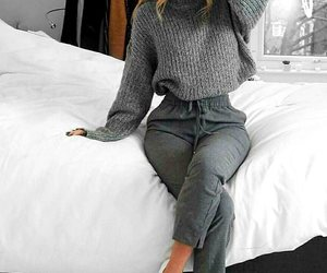 grey pants, clothes rack, and white flats image