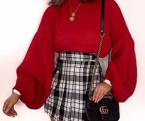 plaid skirts, white turtleneck, and long pink nails image