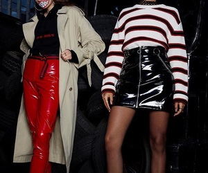 leather skirt, striped sweater, and red leather pants image