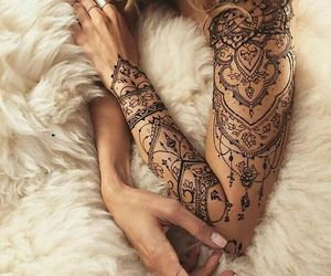 tattoo, arm, and henna image