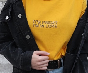 black jacket, jeans, and yellow sweater image