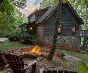 cabin and campfire image