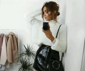 leather skirt and white sweater image