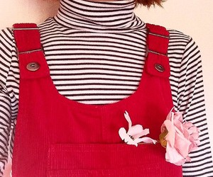 striped turtleneck and red overalls image