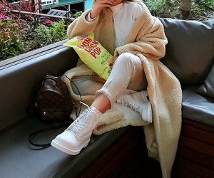 white turtleneck, louis vuitton backpack, and white ankle pants image