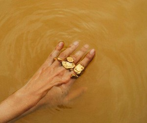 gold, hand, and water image