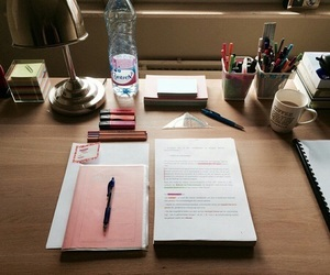 desk, notebook, and pen image