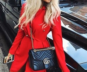red dress, long wavy blonde hair, and black gucci purse image
