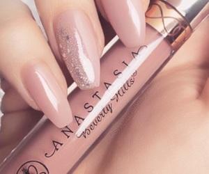 eyeliner, lipstick, and make-up image