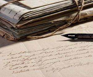 ink, papers, and pen image