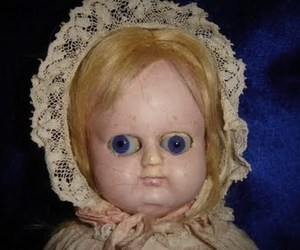 meme and creepy doll image