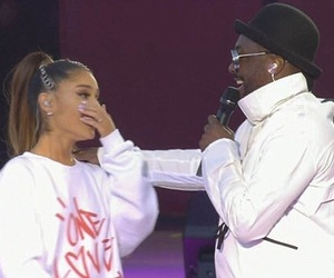 ariana grande, black eyed peas, and one love manchester image