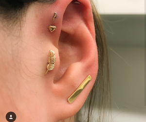 helix, tragus, and ear piercing image