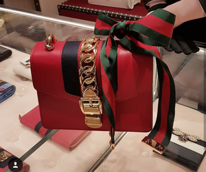 red and gucci purse image