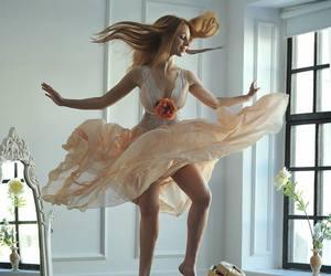 redhead peach dress and balance dance chairs image